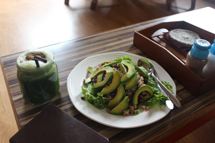 Avocado brown rice salad and green juice at crepe pancake